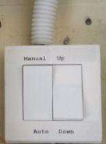 Auto rain sensing or manual awning control switch